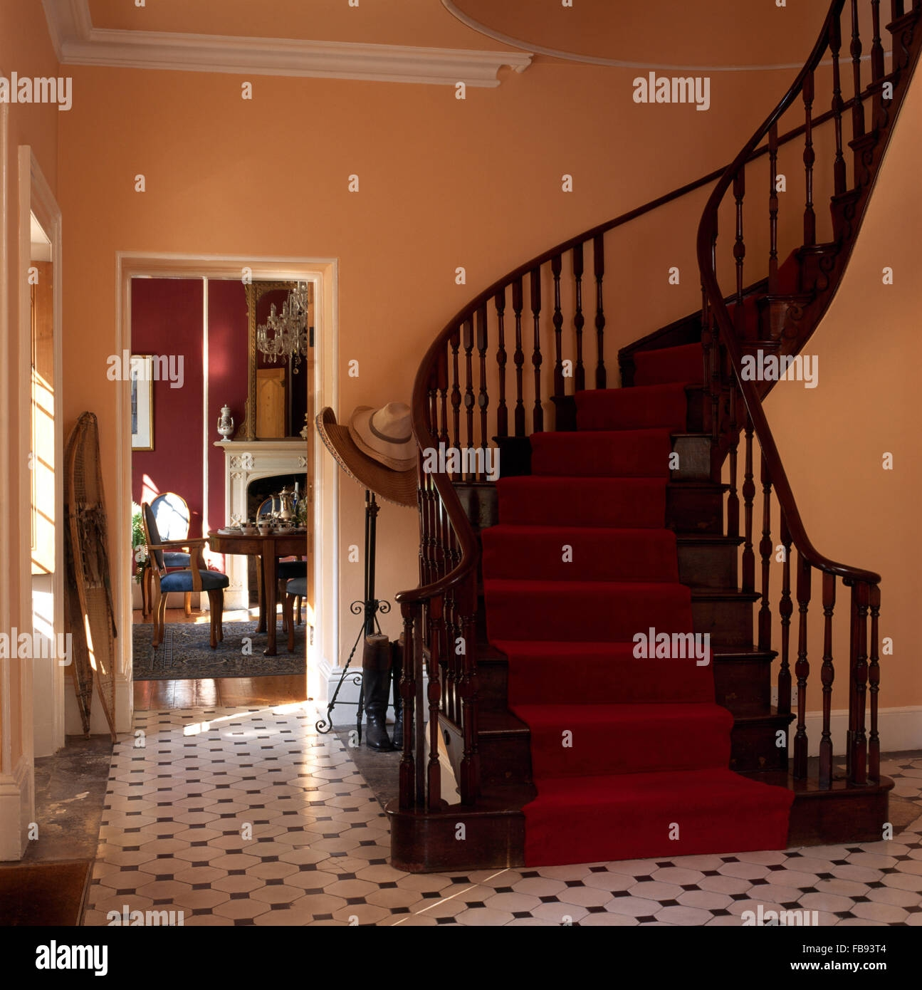 Red Carpet On Sweeping Mahogany Staircase In A Country Hall With A   Black And White Carpet Stairs   Victorian   Striped   Geometric   Low Cost Simple   Unusual