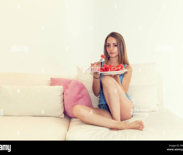 Young Girl In Hot Pants Eating Watermelon On The Sofa