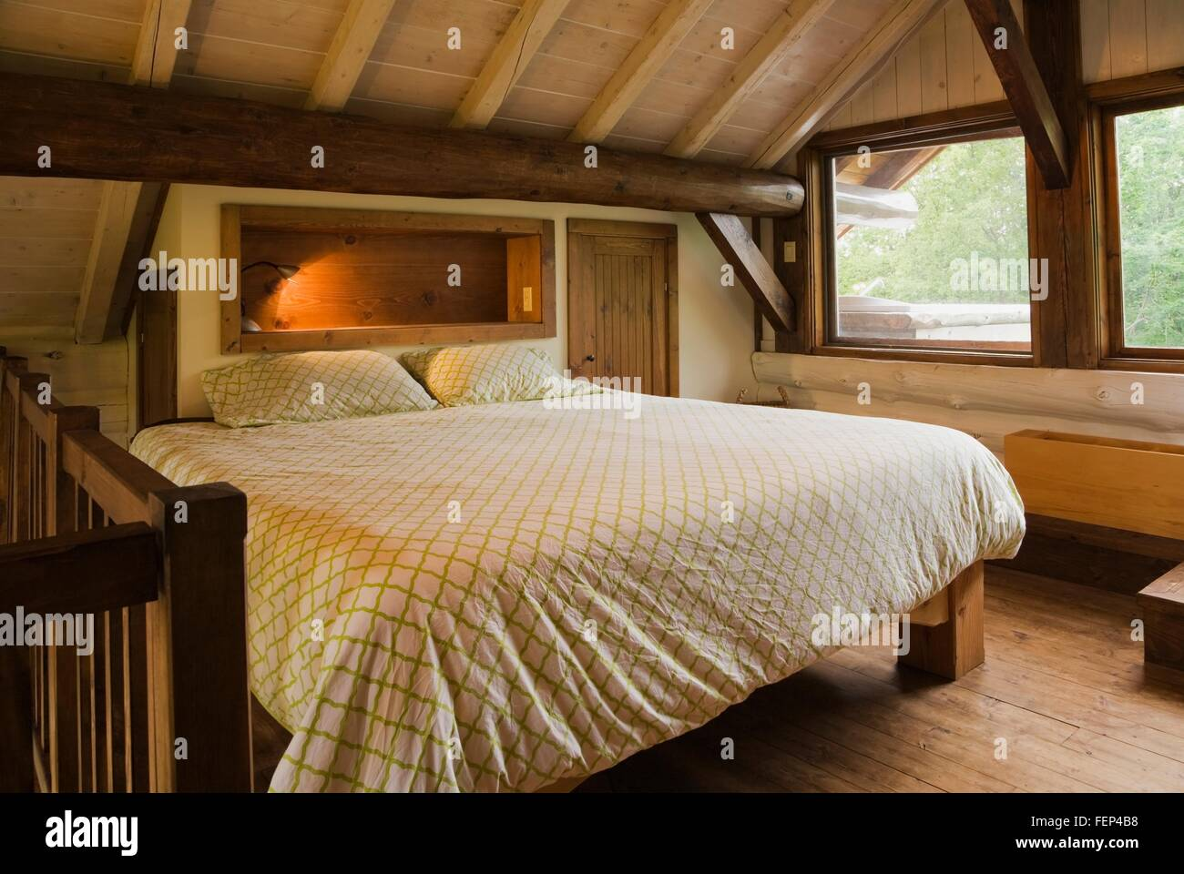 King Size Bed On Wooden Frame In Master Bedroom On The
