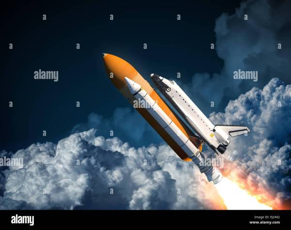 Space Shuttle Flying In The Clouds Stock Photo, Royalty ...