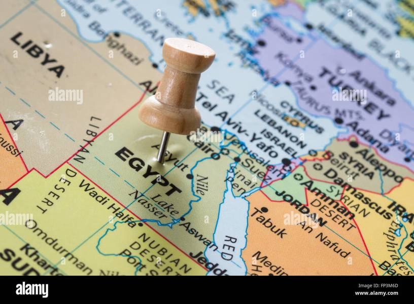 close up of the word Egypt on a world map marked with a push pin     close up of the word Egypt on a world map marked with a push pin