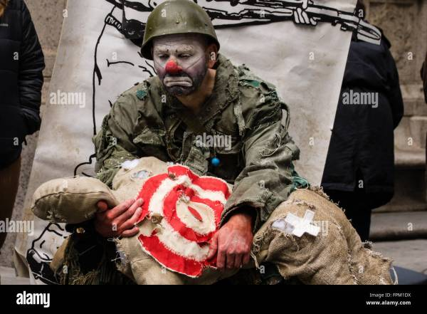 New York City, USA. 19th March 2016. A sad clown soldier ...