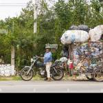 Overloaded Plastic Recycler A Small Motorcycle Towing A Huge Trailer Stock Photo Alamy