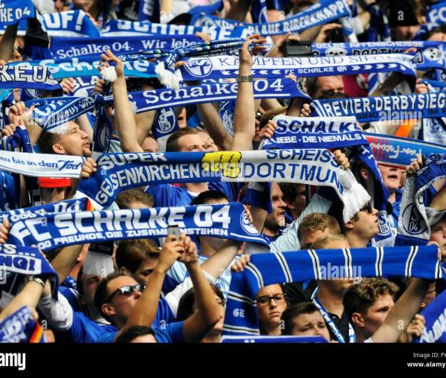 Schalke Fans On The North Stand Holding Up Scarves Fc Schalke 04 Borussia Dortmund Veltins Arena Gelsenkirchen