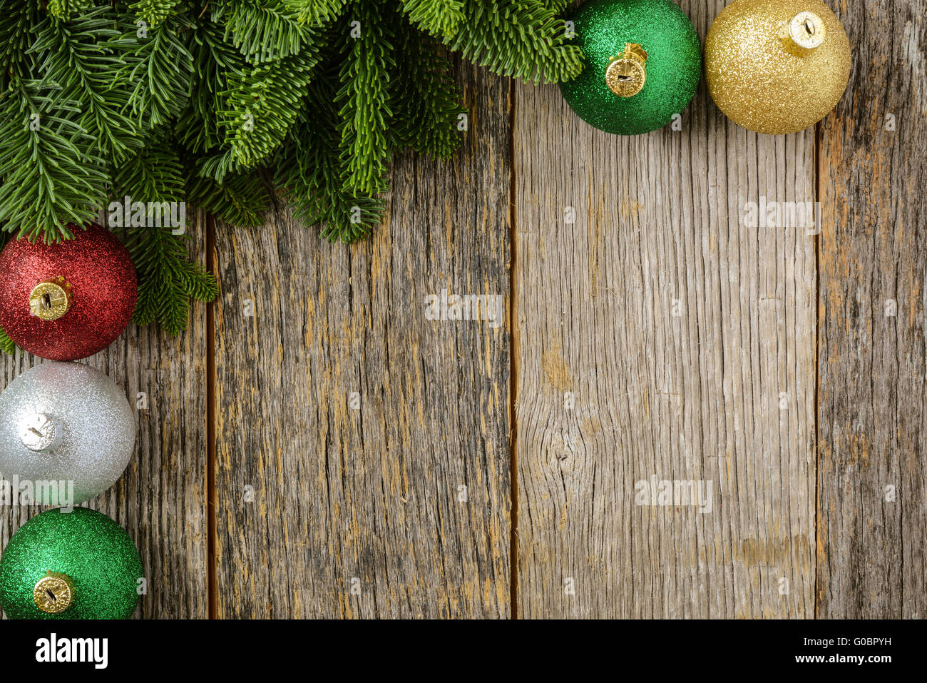 Christmas Pine Needle And Ornaments On A Rustic Wood