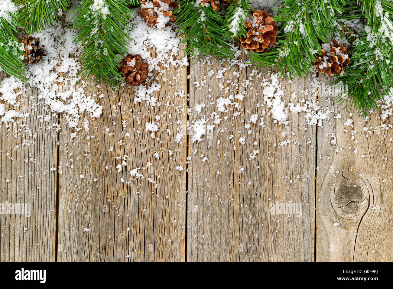 Christmas Border Decorations With Snow On Rustic Wooden