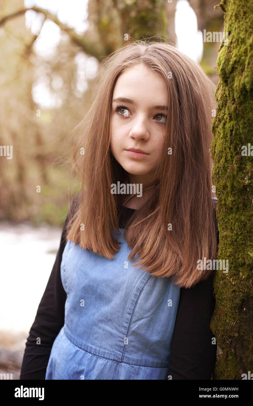 Pretty teenage girl looking upwards whilst leaning on a ... on Small:zikqrscfop8= Teenage Girls  id=59600