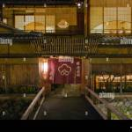 An Exterior Evening View Shows A Footbridge And Traditional Japanese Stock Photo Alamy