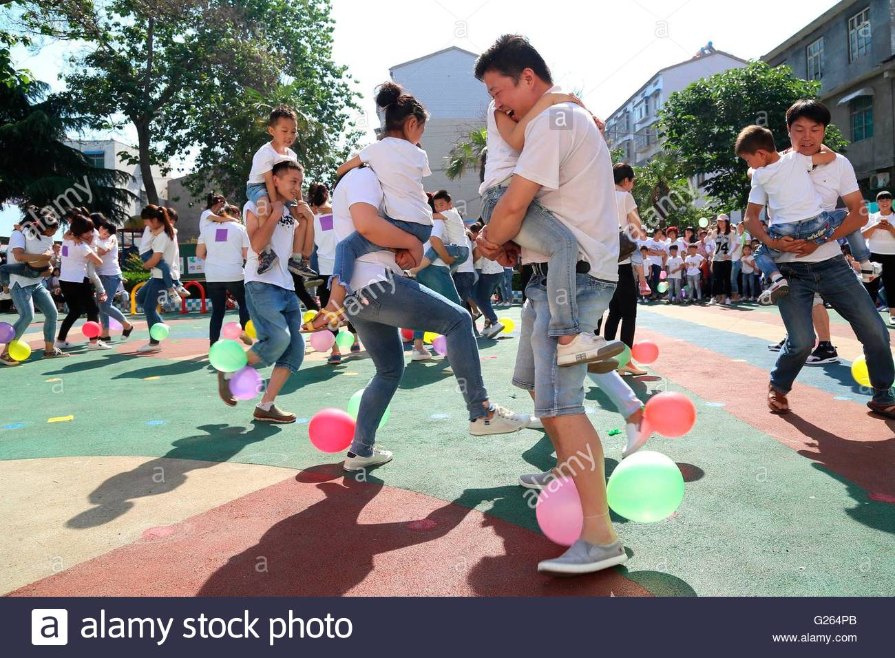 The Parents And Children Take Part In Various Sports Games