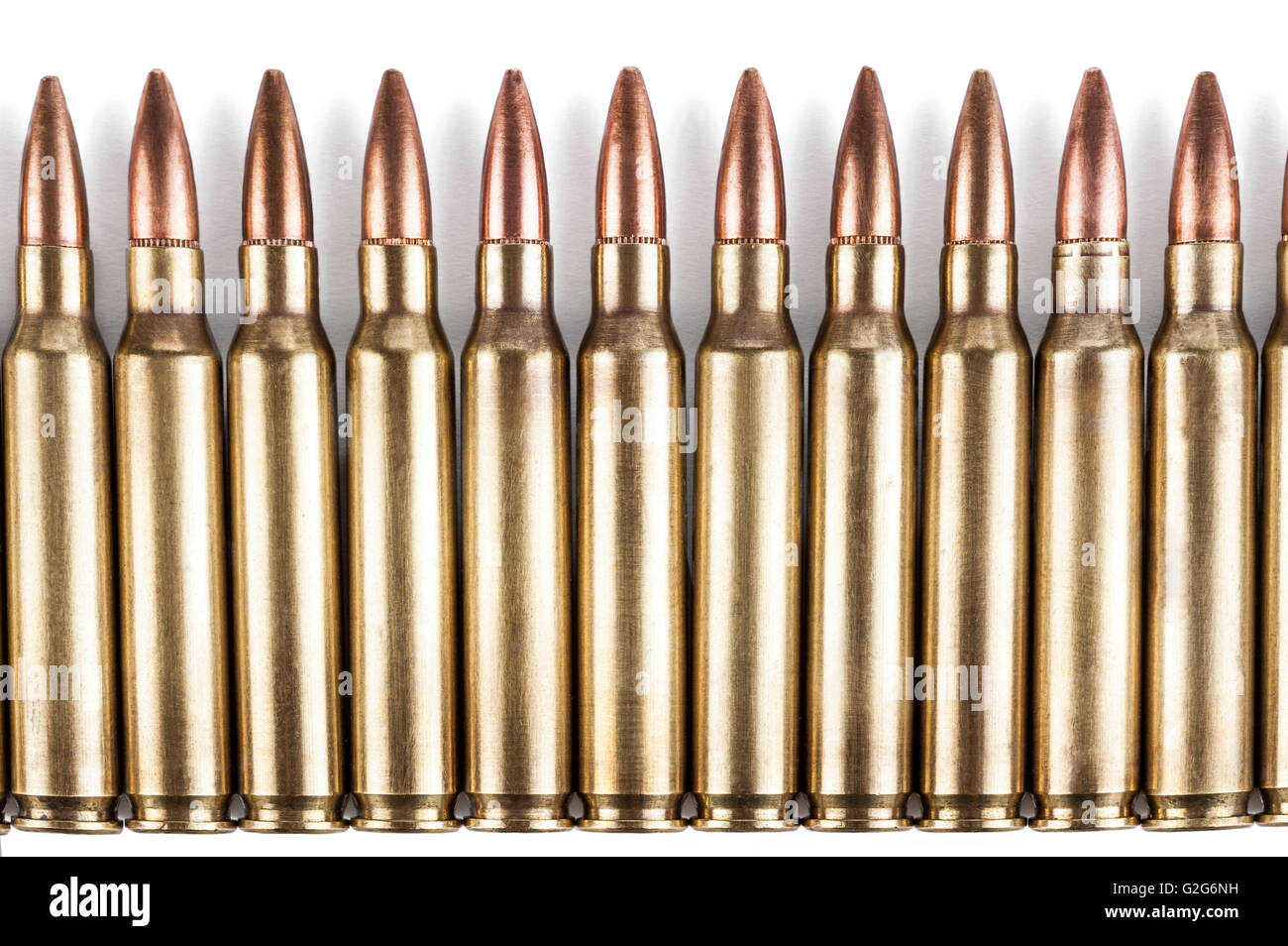 Golden Color Bullets In A Row On White Background With