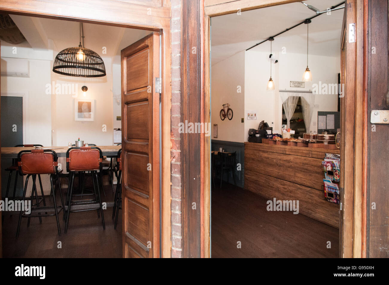 https www alamy com stock photo interior of a rustic coffee shop with a large wooden table in foreground 108904617 html