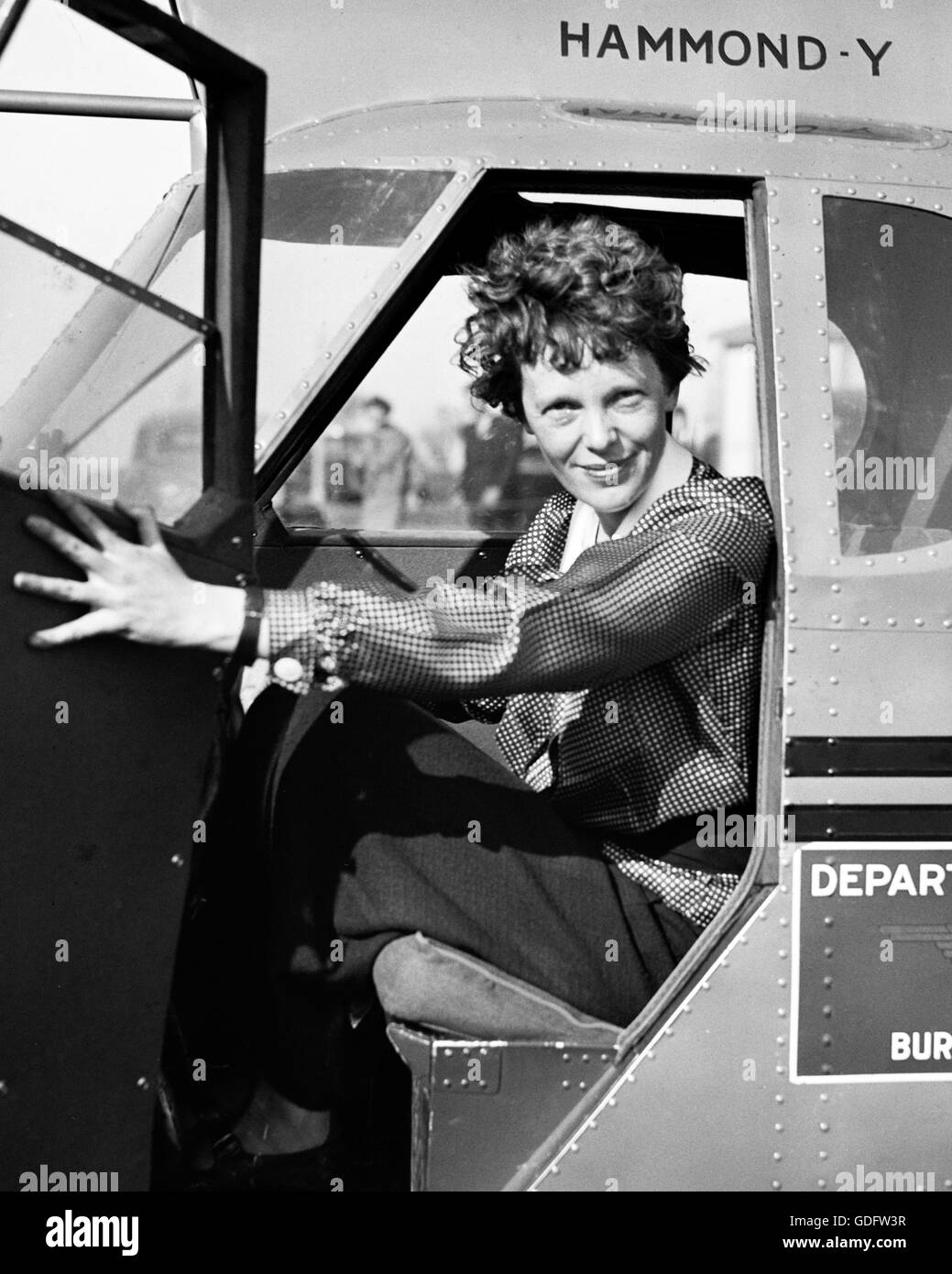 Amelia Earhart In The Cockpit Of An Airplane C
