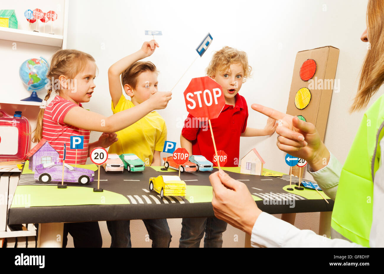 Cute Kids Having Fun Teaching Traffic Signs Stock Photo