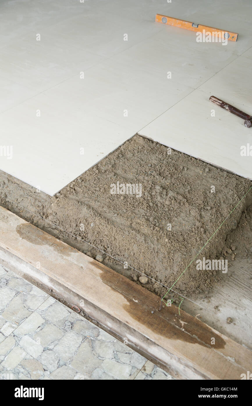 https www alamy com stock photo home improvement with cement mortar for tiles work tile floor adhesive 115205012 html