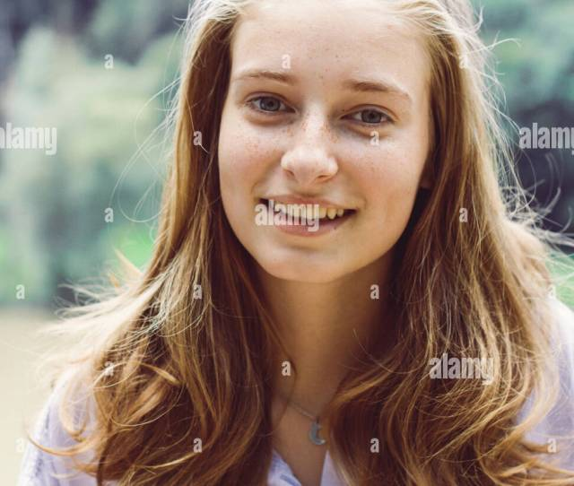Cute Teenage Girl Portrait With Blond Hair Smiles