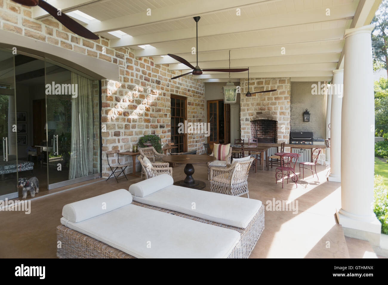 https www alamy com stock photo luxury home showcase patio with stone wall and ceiling fans 118403430 html