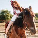 Cowgirl Riding Horse High Resolution Stock Photography And Images Alamy