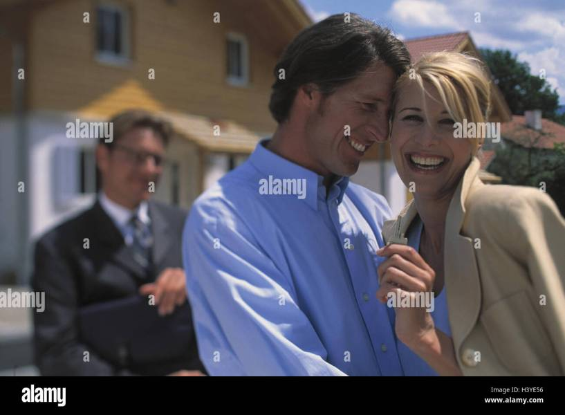 Estate agents  couple  happy  key discharge  outside  house  new     Estate agents  couple  happy  key discharge  outside  house  new building   real estate  real estate seller  businessman  broker  man  married couple   young