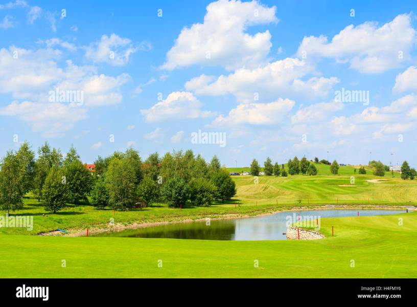 PACZULTOWICE GOLF CLUB  POLAND   AUG 9  2014  lake on golf course     PACZULTOWICE GOLF CLUB  POLAND   AUG 9  2014  lake on golf course green  play area on sunny summer day  Golfing is becoming a popular sport among  wealthy