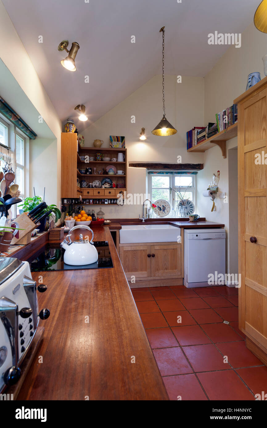 https www alamy com stock photo galley kitchen with a quarry tile floor in a period cottage 123409424 html