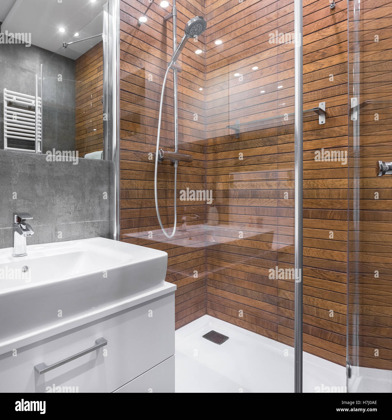 https www alamy com stock photo modern bathroom with wood effect shower mirror and white sink 125170598 html