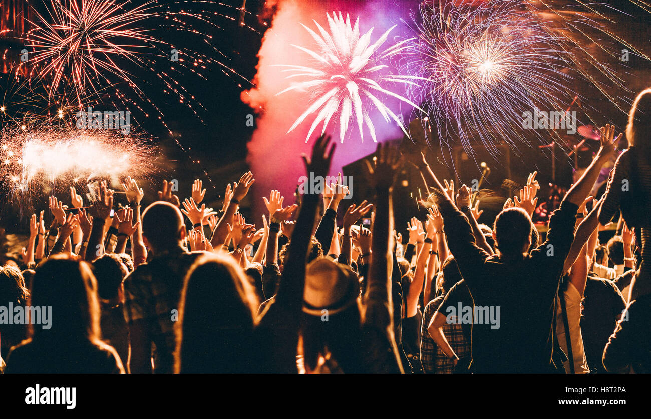 cheering crowd and fireworks   New Year celebration concept Stock     cheering crowd and fireworks   New Year celebration concept
