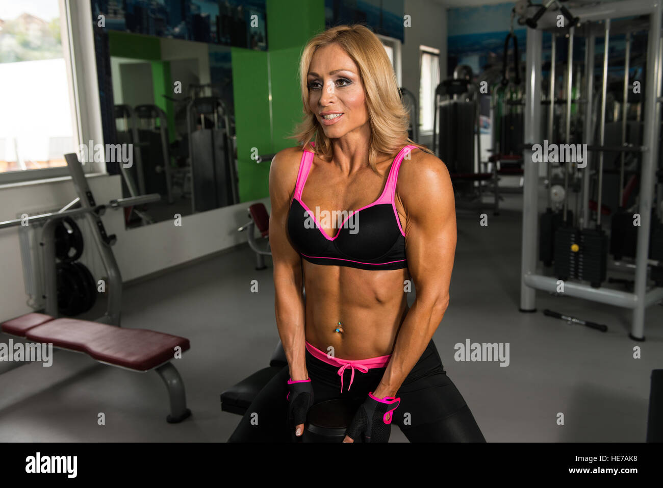 Mature Fitness Woman Working Out Ass In Fitness Center