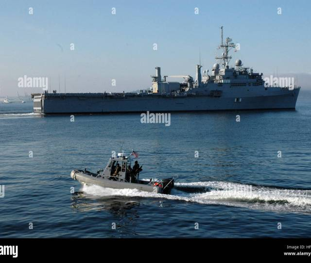 C  Seattle Wash Aug   A Mobile Security Detachment Boat Escorts The Amphibious Transport Dock Ship Uss Cleveland Lpd  Away