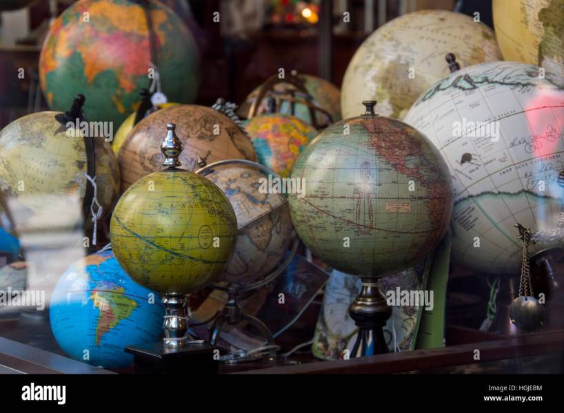 vintage world globe travel wanderlust continents map world map Stock     vintage world globe travel wanderlust continents map world map voyager  madrid show window map store world globe store shop gift