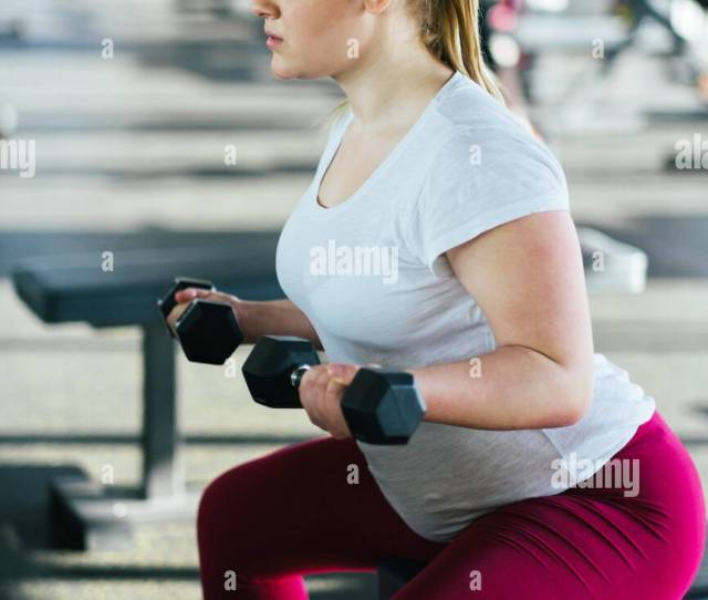 Beginner Chubby Girl Exercising In Fitness Club Stock Image