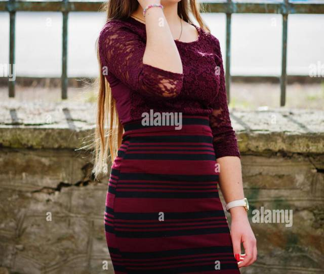 Young Chubby Teenage Girl Wear On Red Dress With Sunglasses Posed Against Iron Fence