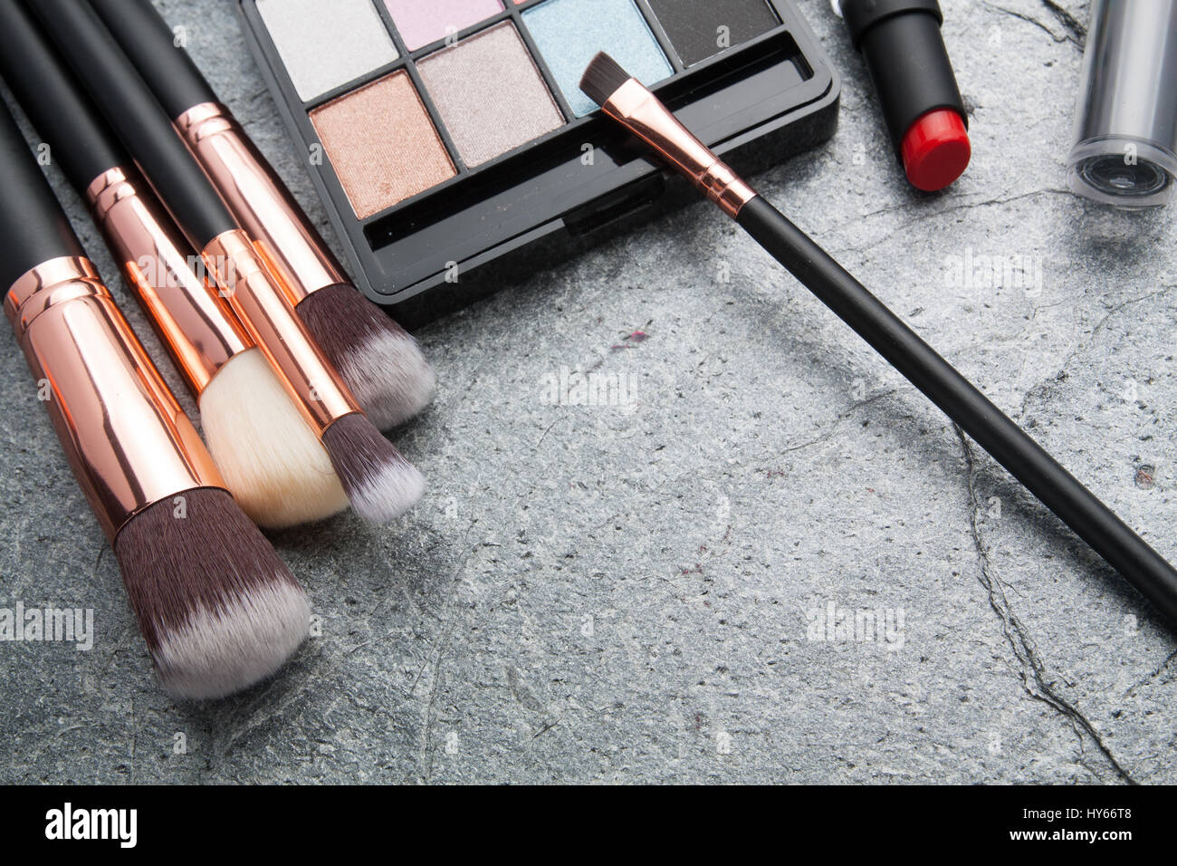 various makeup products on dark background with copyspace Stock     various makeup products on dark background with copyspace