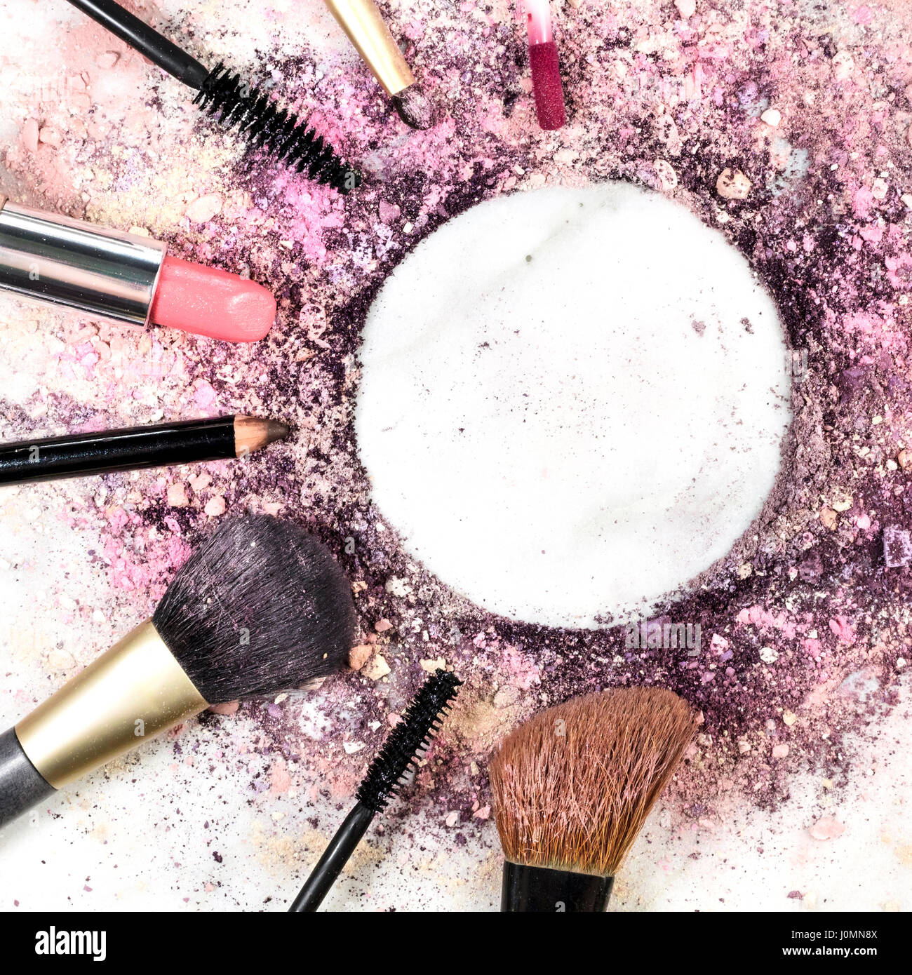 Crushed Powder Makeup Stock Photos   Crushed Powder Makeup Stock     Makeup brushes  pencil  lipstick and other objects  forming a frame on a  light