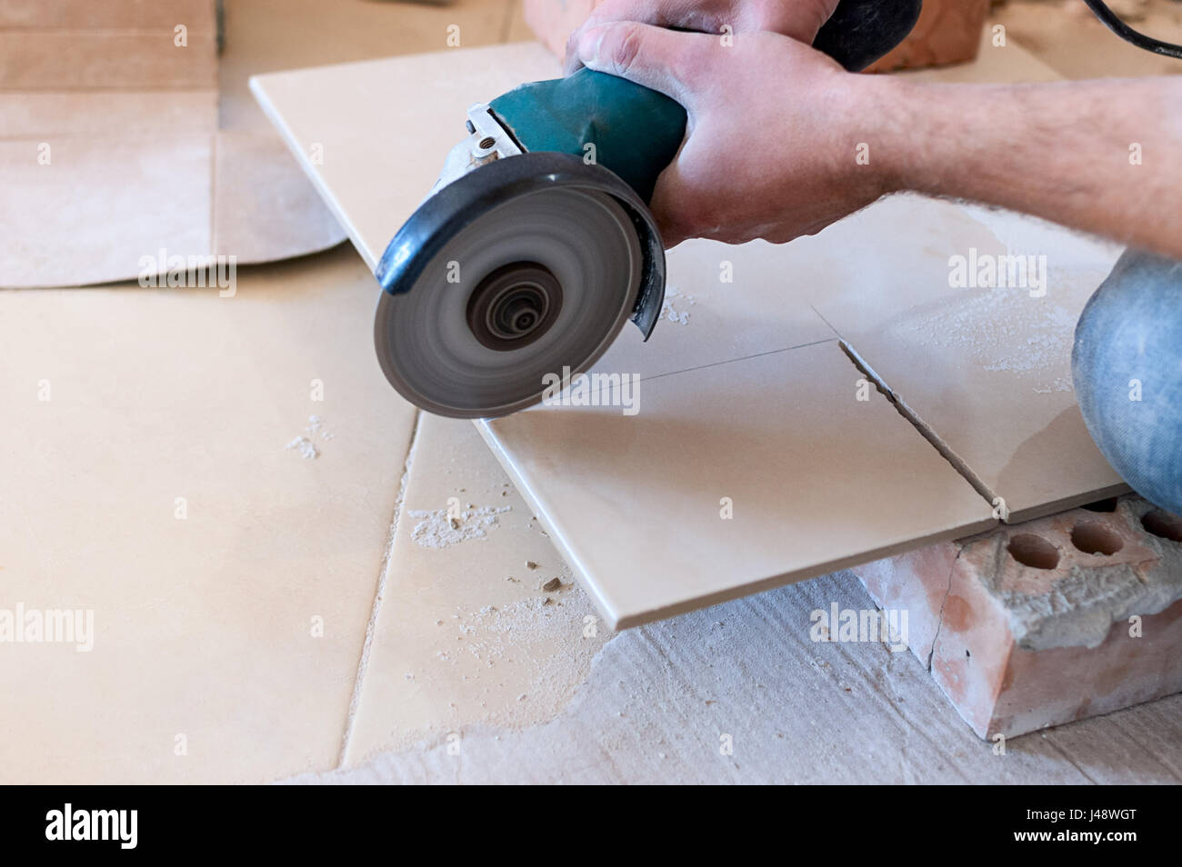 https www alamy com stock photo a construction worker cutting a tile using an angle grinder 140337256 html