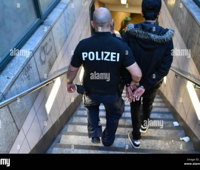 Police Officers Escort A Suspected Pickpocket In The Borough Of Kreuzberg In Berlin Germany  A Special Police Group Has Been Patrolling