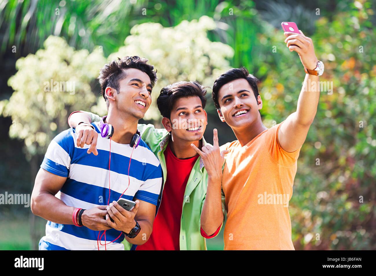 3 Indian College Boys Friends Taking Selfie Phone In Park