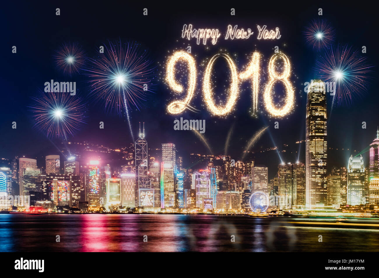 Happy new year 2018 firework over cityscape building near sea at     Happy new year 2018 firework over cityscape building near sea at night time  celebration Happy new year countdown