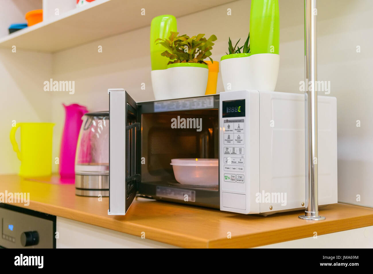 https www alamy com open white microwave oven with plastic bowl inside image150200560 html