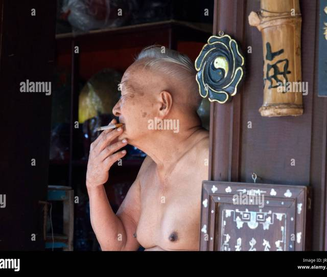 Man Smoke A Cigaret Naket Outside The House Hoi An Vietnam Stock
