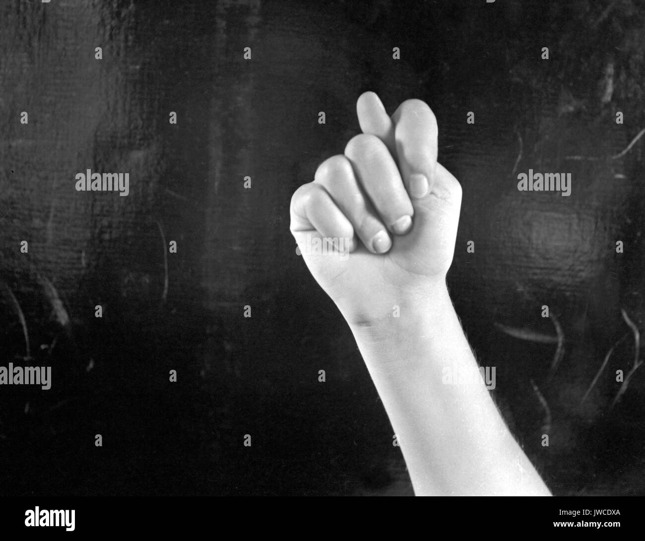 Fingerspelling Stock Photos   Fingerspelling Stock Images   Alamy Hand on black background fingerspelling the letter T in sign language     Stock Image