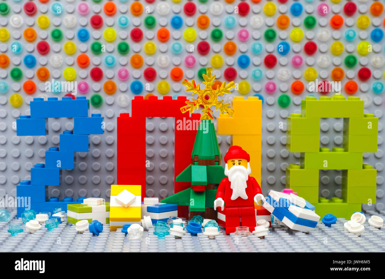 Tambov  Russian Federation   June 15  2017 New year 2018 concept by     Tambov  Russian Federation   June 15  2017 New year 2018 concept by Lego   Numbers 2018  christmas tree  Santa Clause and presents on Lego gray basepla