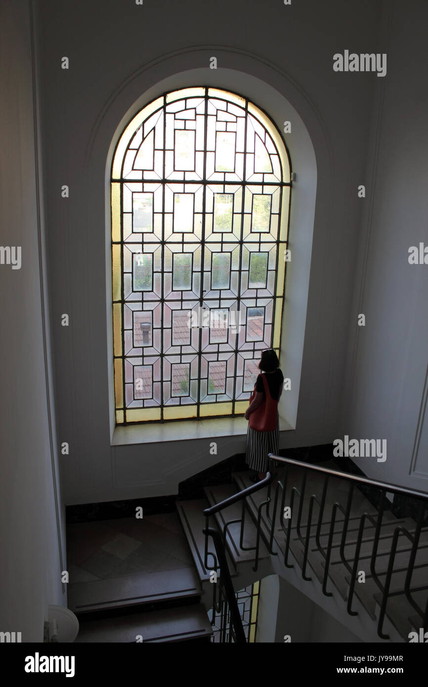 Portrait Of Thoughtful Woman Looking Out Of Window Beside Stairs | Window Design For Stairs | Stylish | House Box Window | U Shaped | Big Window | Luxury Window