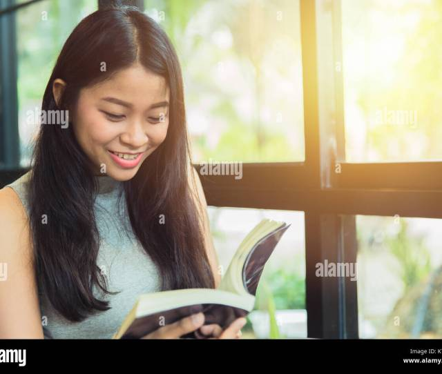 Enjoy Relax Times With Reading Book Asian Women Thai Teen Smile With Book In Coffee Shop Vintage Color Tone