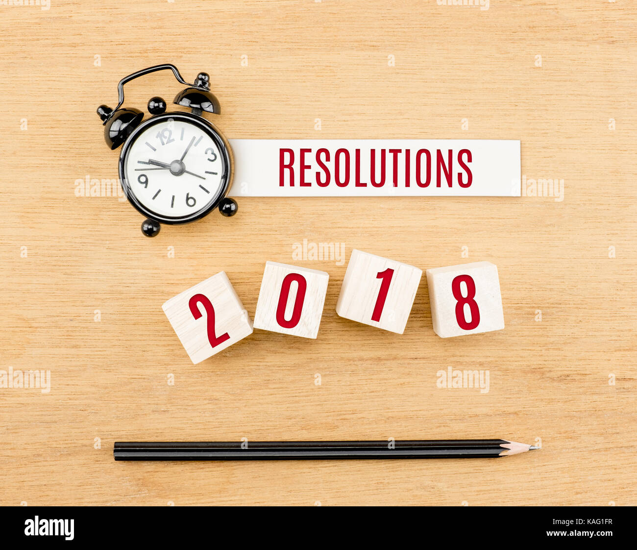 Resolutions New Year Red On Wood Cube With Pencil And Clock Top Stock Photo Royalty Free