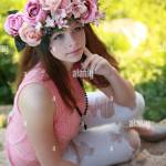A Beautiful Young Woman Wearing A Colorful Flower Crown And Stock Photo Alamy