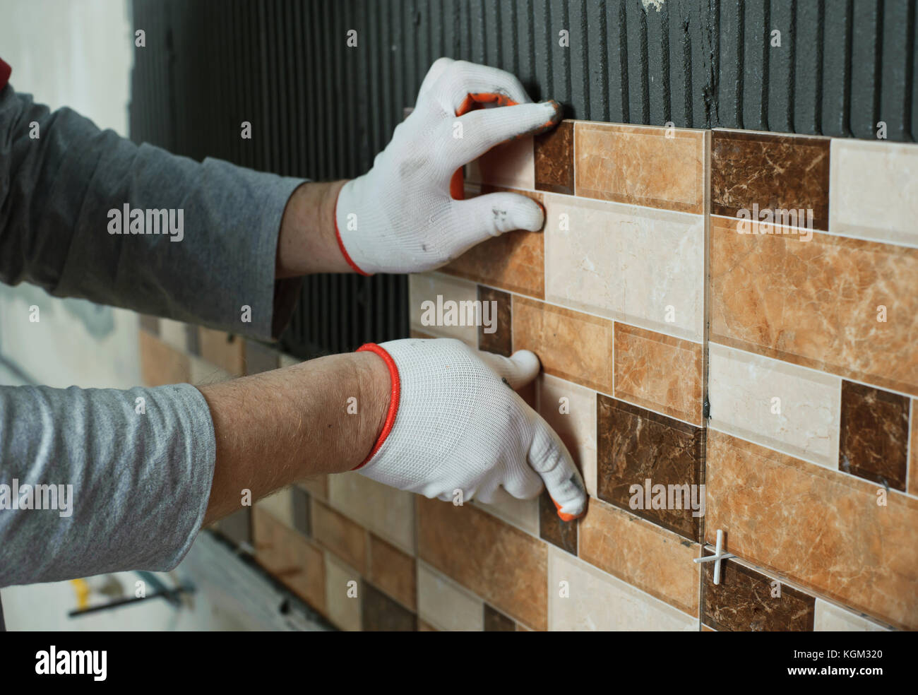 https www alamy com stock image laying ceramic tiles tiler placing ceramic wall tile in position over 165169256 html