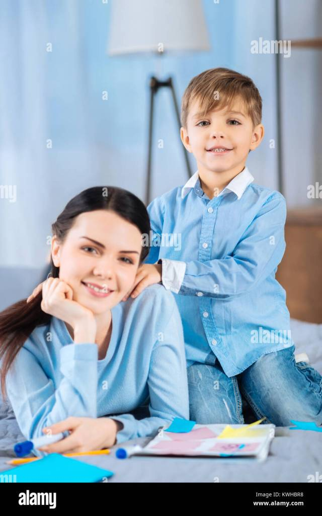 Caring Son Giving His Mother Massage On Bed