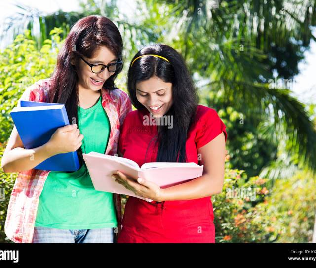 2 Indian Teenager College Girls Students Standing In Garden Thumbsup