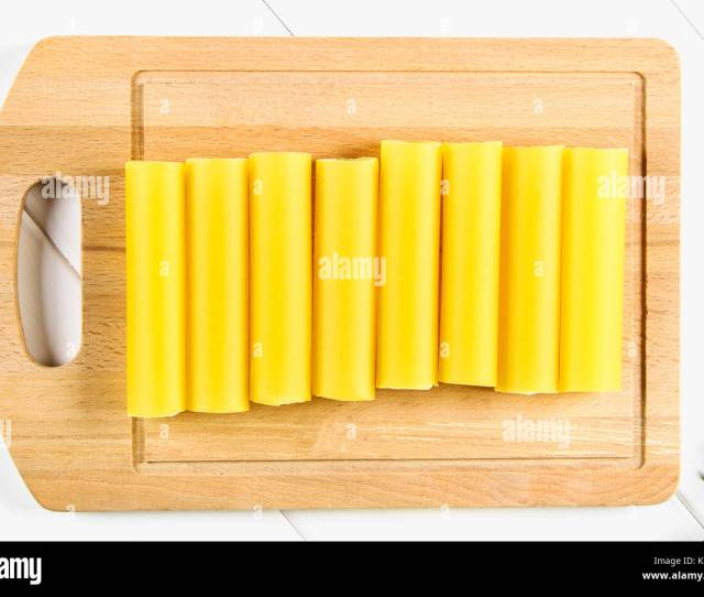 Raw Tube For Stuffing Stuffing Surrounded By Ingredients For Cooking Parmesan Cheese Tomato Minced Meat On A White Wooden