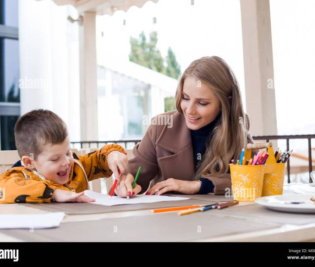 Mom With Boy Draw Colored Pencils